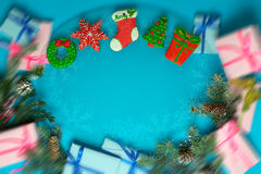 Christmas gingerbreads and snow-covered fir-tree branches with c Royalty Free Stock Photos