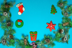 Christmas gingerbreads and snow-covered fir-tree branches with c Royalty Free Stock Image