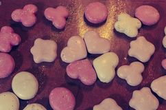 Gingerbreads in white and pink. Christmas gingerbreads with white and pink icing on the kitchen counter stock image
