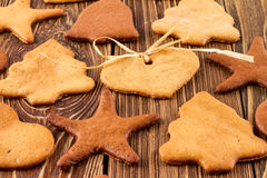 Christmas gingerbreads on wooden background, Christmas or New Year background Royalty Free Stock Photography