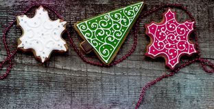 Christmas gingerbreads on wooden background Stock Photography