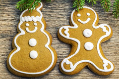 Christmas gingerbreads on a wooden table with fir branches Royalty Free Stock Photo