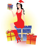 Christmas girl. In red with gift boxes Royalty Free Stock Photography
