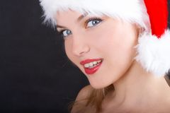 The christmas girl. The beautiful girl in a christmas red cap Stock Photography