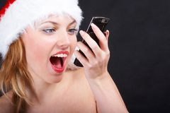 The christmas girl. With phone Royalty Free Stock Images