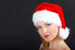 The christmas girl. The beautiful girl in a christmas red cap Stock Photos