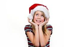 Christmas girl. Hopeful christmas girl with xmas hat, with copy space stock photo
