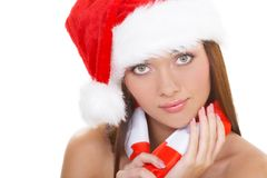 The christmas girl. The beautiful girl in a christmas red cap Stock Image