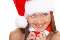 The christmas girl. The beautiful girl in a christmas red cap Royalty Free Stock Photography