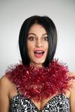 Christmas girl. A Christmas girl with tinsel on her neck stock image