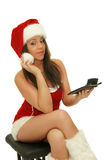 Christmas girl. Picture of the beautiful christmas girl with calculator on the white background royalty free stock photos