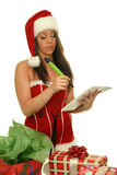 Christmas girl. Christmas brunette girl with pencil and bloc notes thinking and writing Royalty Free Stock Photos