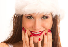 Christmas Girl Smiling Wearing White Winter Hat  Royalty Free Stock Photo