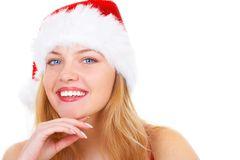 The christmas girl. The beautiful girl in a christmas red cap Royalty Free Stock Image