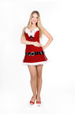 Christmas girl. The girl in red and white dress  on white Royalty Free Stock Photo