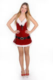 Christmas girl. The girl in red and white dress  on white Royalty Free Stock Image