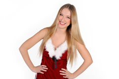 Christmas girl. The girl in red and white dress isolated on white Royalty Free Stock Photos