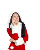 Christmas girl. Young happy smile woman wear Santa Clause costume think look up corner side to empty copy space, isolated over white background Stock Photos