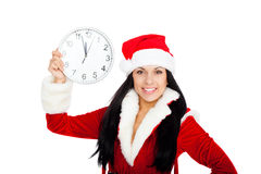 Christmas girl. Young happy smile woman wear santa clause costume, new year party girl looking at camera hold clock, isolated over white background stock photo