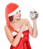 Christmas girl with alarm clock Stock Image