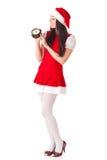Christmas girl with alarm clock. Stock Image