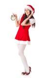 Christmas girl with alarm clock. Stock Photos