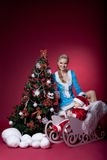 Christmas girl and baby santa claus portrait Stock Photo