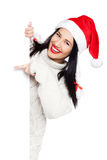 Christmas girl with blank signboard Stock Images
