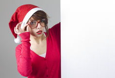 Christmas Girl with blank table Stock Image