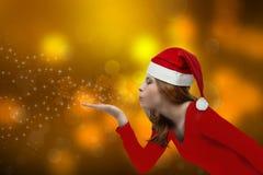 Christmas girl blowing stock photos