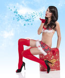 Christmas girl blowing a kiss royalty free stock image