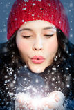 Christmas girl blowing snow in hands Royalty Free Stock Images