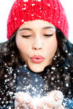 Christmas girl blowing snow in hands Stock Image
