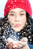 Christmas girl blowing snow in hands Royalty Free Stock Photos