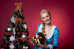 Christmas girl in blue cloth with gift box Royalty Free Stock Images