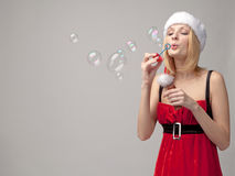 Christmas girl with bubble blower Stock Photography