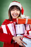 Christmas girl carrying presents Royalty Free Stock Photo