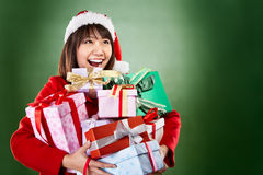 Christmas girl carrying presents Stock Photography