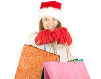 Christmas girl carrying shopping bags Stock Photography