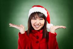 Christmas girl with choice Royalty Free Stock Photo