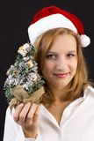 Christmas girl with christmas tree Stock Images