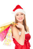 Christmas girl with colorful bags Stock Images