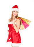 Christmas girl with colorful bags Royalty Free Stock Images
