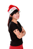 Christmas girl with confident pose. Portrait of young Asian woman wearing Santa's hat and smiling to camera with arms crossed, isolated on white background Stock Images