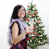 Christmas: girl congratulates with glass of wine Royalty Free Stock Image