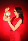 Christmas girl with cristal golden ball in her hand Stock Images