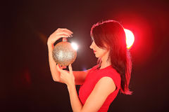 Christmas girl with cristal golden ball in her hand Royalty Free Stock Photo