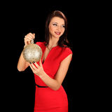 Christmas girl with cristal golden ball in her hand Stock Photos