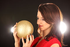 Christmas girl with cristal golden ball in her hand Royalty Free Stock Photos