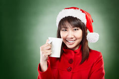 Christmas girl with cup of drink Royalty Free Stock Images